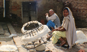 The carpet industry supply chain in action:  villagers throughout Bhadohi work at home weaving, carding and spinning wool.